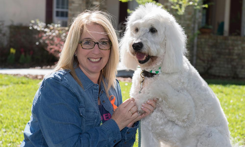 Dr. Wendy Rice with Milo the therapy dogs